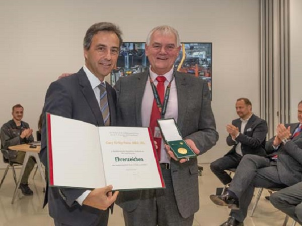 Graz gives Gary Kirtley-Paine a golden medal of honour